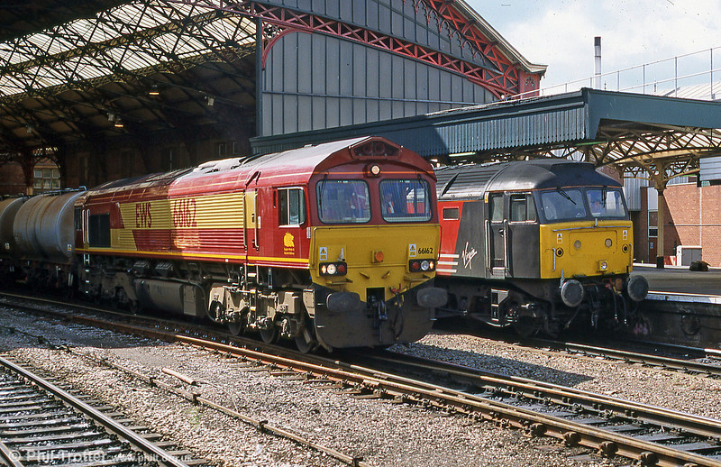 66162 passes through Bristol Temple Meads with fuel tankers, while 47843 'Vulcan' waits to leave with a VXC service for the North of England in September 2001.