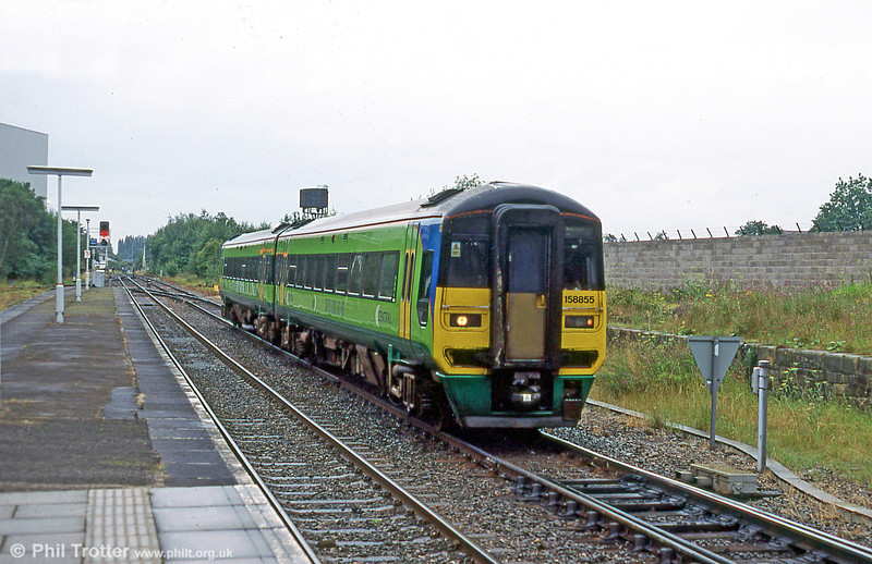 Central Trains-liveried 158855 on a Birmingham - Chester service approaching Wrexham General