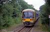 Network South East liveried 166211 heads away from Hanborough towards Worcester in July 1999.