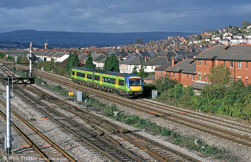 A Central Trains class 170 heads for the Midlands past East Usk Yard on 1st November 2000.