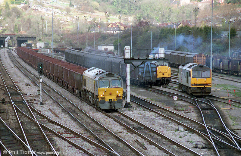 A second shot of 59101 'Village of Whatley' passes Alexandra Dock Junction, Newport with Llanwern to Port Talbot iron ore empties on 18th March, 1997. 37672 and 60082 'Mam Tor' are in the yard.