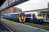 First North Western 158756 passes 175109 at Chester.