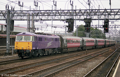 Porterbrook liveried 87002 at Crewe in August 2003. The loco has been preserved in main line condition by the AC Loco Group. 87002 had the distinction of hauling the final Virgin Class 87 hauled train on 22nd December 2006.