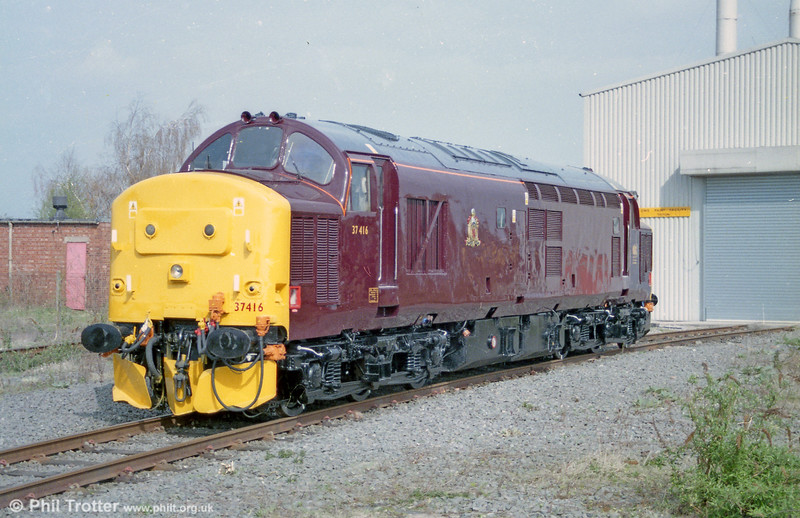 Class 37/4 37416 in Royal Scotsman livery stands fresh from the paint shop on Toton Depot on 12th April 2004.