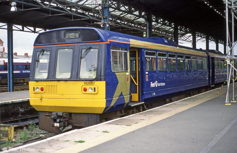 142007, newly painted in First North Western livery, at Chester.