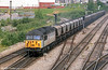 56018 heads through Alexandra Dock Junction, Newport on 9th May, 1997.