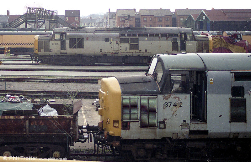 A view across Cardiff Canton Depot with 37402 and 37676 present in 2003.