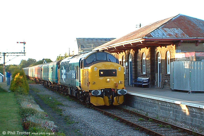 'Large logo' liveried class 37 no. 37425 draws into Pantyffynnon with the 1745 from Llandrindod Wells to to Cardiff Central and Rhymney on 21st July 2005. The same combination was used on each of the daily services run in conjunction with the Royal Welsh Show from 18th-21st July
