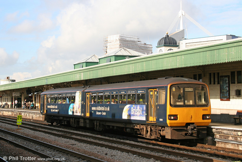 143620 in the drab 'Visit Bristol' advertising livery, waits to leave Cardiff Central for Bristol Temple Meads on 22nd October 2005.
