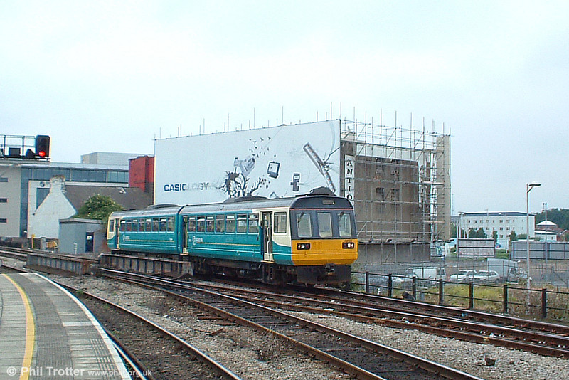 Arriva has made progress with repainting rolling stock into corporate livery. Here 142002 approaches Cardiff Central with the 0942 service to Aberdare on 25th June 2005.