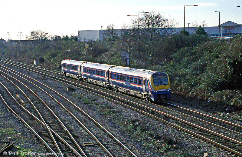 Dusk falls over Newport ADJ as 175105 passes with a service for Manchester Piccadilly in January 2005.