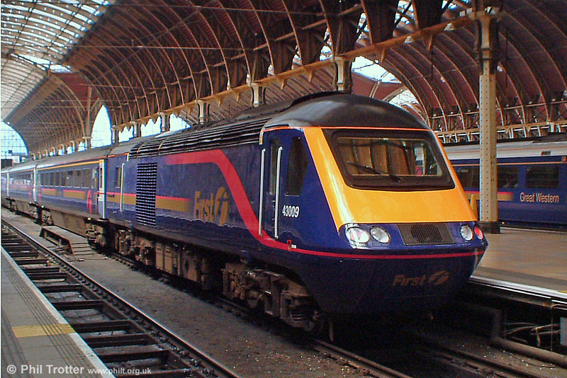 First Great Western HST power car 43 009 waiting to leave Paddington at the rear of the 14.00 service to Penzance on 21st June 2005. This locomotive has been refurbished and is one of two fitted with an MTU 16V 4000 engine, designed to extend its life to 2012-16.