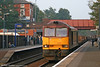 EWS liveried 60043 rushes through Kidderminster with a diverted freight on on 15th October 2005.