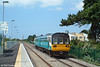 Arriva-liveried class 142 unit no. 142002 approaches Rhoose station on the Vale of Glamorgan line with the 1154 service from Bridgend to Caerphilly on 16th July 2005.