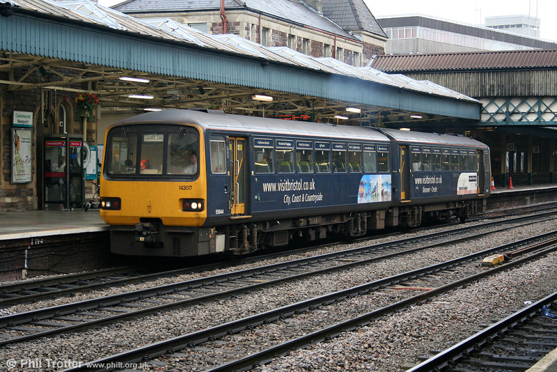 Advertising liveried 143617 pauses at Newport on its way to Cardiff Central on 18th October 2005.