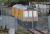 Network Rail retained two former class 121 'bubble car' units at Severn Tunnel Junction as Emergency Units for the Severn Tunnel. Former 55027 and 55031 were kept in a secure compound and were difficult to photograph. The pair are seen here on 2nd October 2005, with former 55031, now numbered 960303, to the fore.