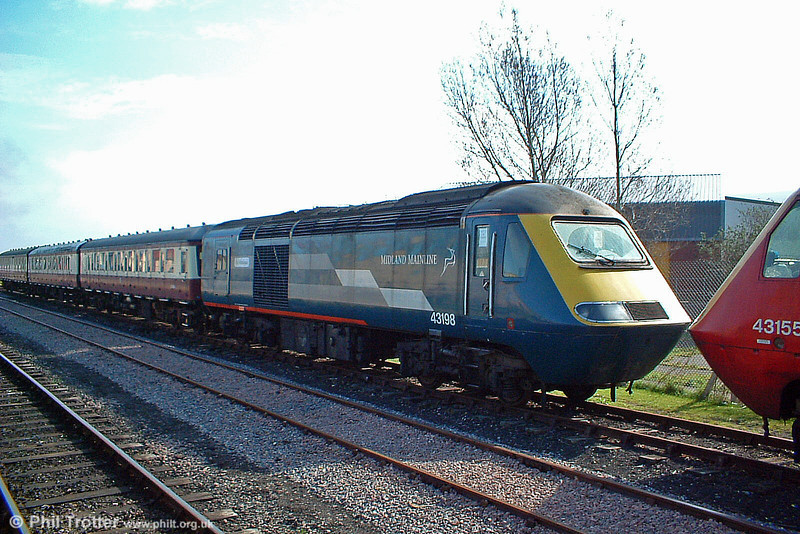 After many years of front-line service, many HST power cars are now in store pending further work being found for them. Midland Mainline liveried 43198 'Rio Victorious' is seen at Minehead, West Somerset Railway on 18th March 2005.