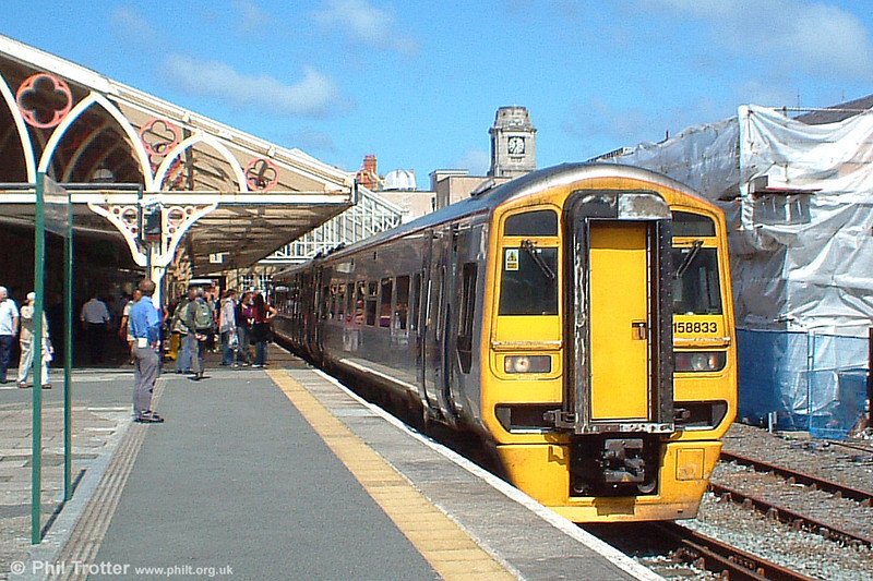 Arriva's 158833 prepares to leave Aberystwyth with the 1132 to Birmingham New Street on 3rd August, 2005.