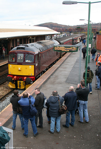 West Coast Railways 33207 attracts attention at Caerphilly while working the 1256 from Cardiff to Rhymney on 4th December 2005.