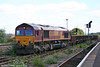 66054 draws into Didcot Yard with a permanent way spoil train on 28th August 2005.
