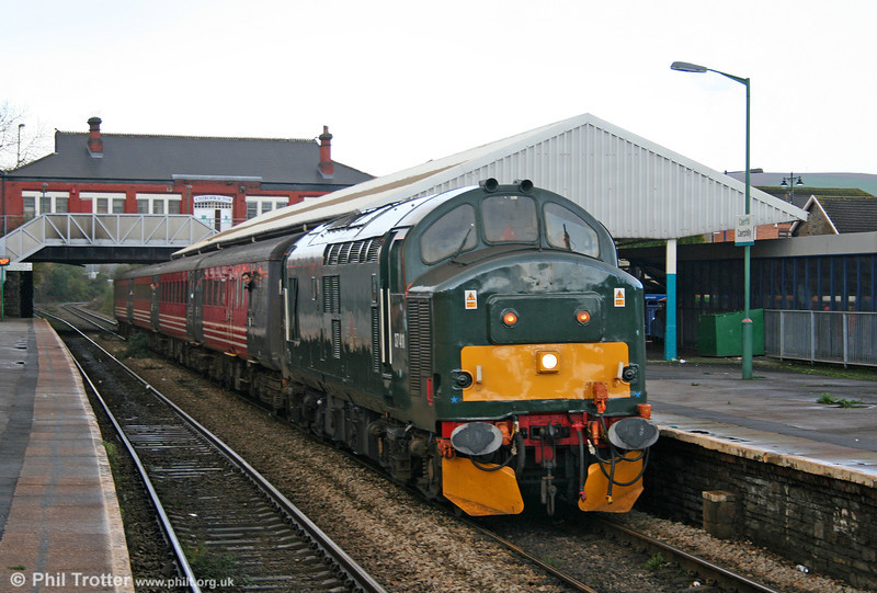 Green liveried 37411 at Caerphilly with the 1215 Rhymney to Cardiff on 12th November 2005.
