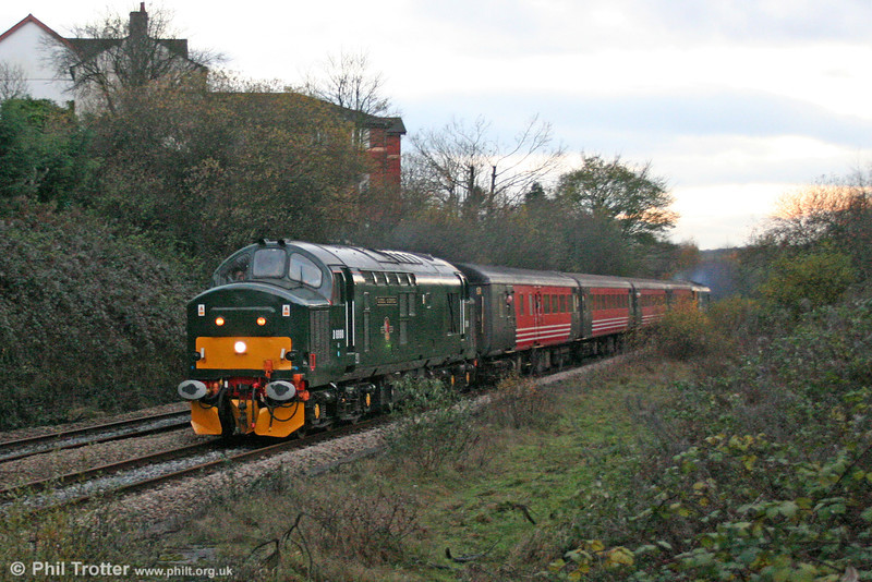In failing light, and with the camera set to 1500ASA (!), green liveried 37 411, now named 'Caerphilly Castle/Castell Caerffili' approaches the town after which it is named with the 1515 from Rhymney on 4th December 2005.