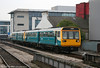 Arriva 142069 leads a sister unit on a Valley Lines service into Cardiff Central on 18th October 2005.