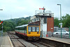Arriva/Valley Lines 142076 rolls into Bargoed with the 1142 service to Cardiff on 25th June 2005. The signal box formerly stood at Cymmer Afan and was rebuilt here in 1970.