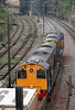 Two unidentified DRS class 20s head away from the tunnel at Crewe with a nuclear flask in tow on 5th August 2006.