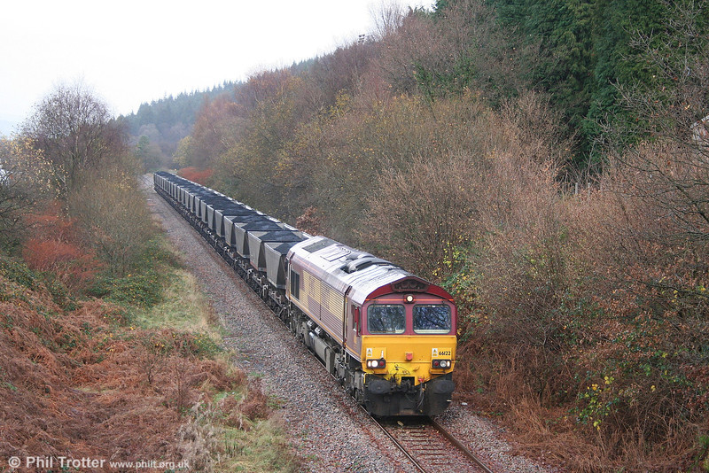66122 at Resolven, Vale of Neath, with a train of HAAs forming 6C32, 1310 Cwmgwrach to Aberthaw Power Station on 2nd December 2006.