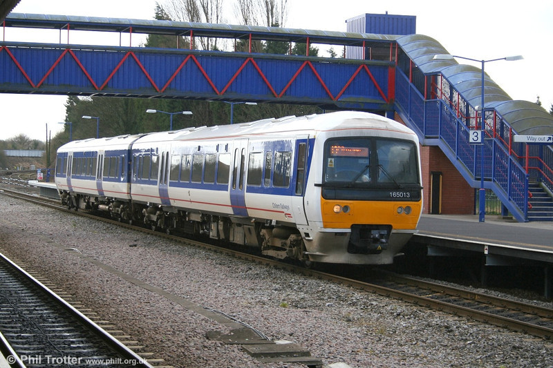 All of Chiltern Railways class 165 dmus have been refurbished and have been equipped with air conditioning, presenting a much updated travelling environment. 165013 is seen at Princes Risborough with a terminating service from Marylebone on 28th March 2006.