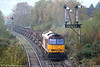 60021 'Star of the East' approaches Tondu on a chilly autumn Sunday morning with the diverted 6H25, the 0957 Margam - Llanwern loaded steel slabs. 66169 brings up the rear. 5th November 2006.