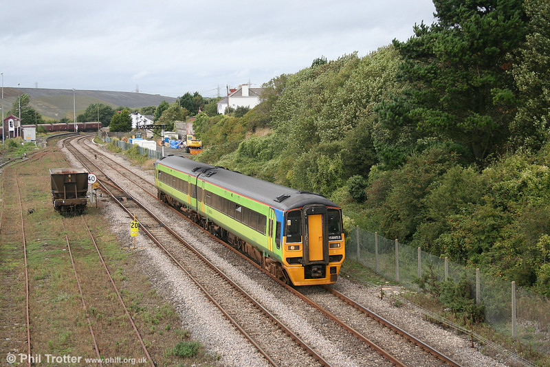 ATW's 158853 passes Aberthaw with the diverted 1105 Milford Haven to Manchester Piccadilly on 2nd September 2006. Note that in the background the down platform and loop of Aberthaw station still exists, together with Aberthaw East Signal Box built for the Barry Railway in 1897.