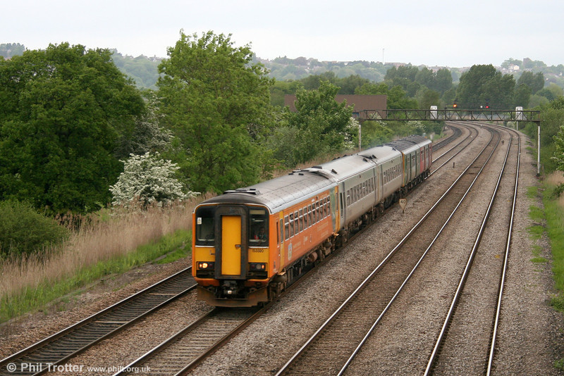 153320 leads a unit 'lash-up' for a sporting event in Cardiff at Duffryn on 20th May 2006.
