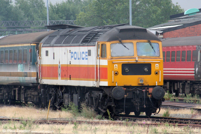 47829 in store at Crewe on 5th August 2006. The loco still carries the Police 'Jam Sandwich' livery applied in March 2002 as part of a British Transport Police rail safety campaign.