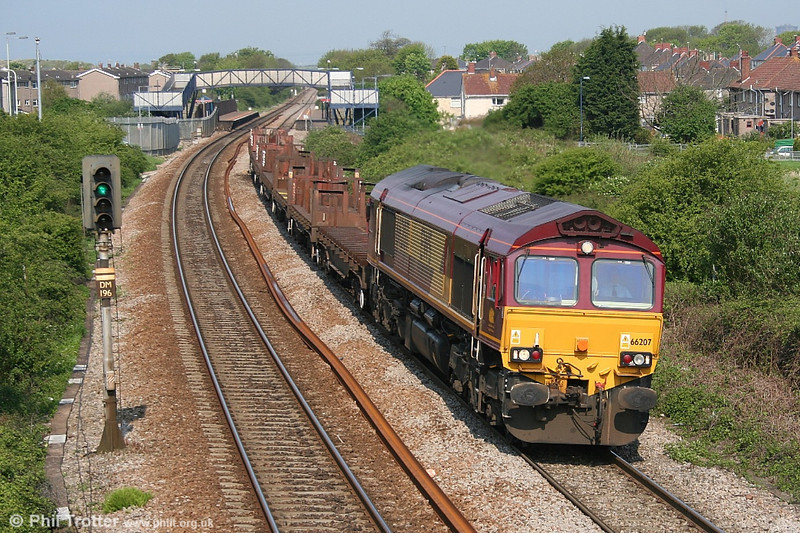 EWS 66207 passes through Pyle on 11th May 2006 with empty steel flats.
