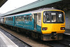 One of the first Arriva Trains Wales '143s' to be repainted in Arriva corporate livery, 143 616 brings up the rear of a Merthyr Tydfil service at Cardiff Central on 28th May 2006.