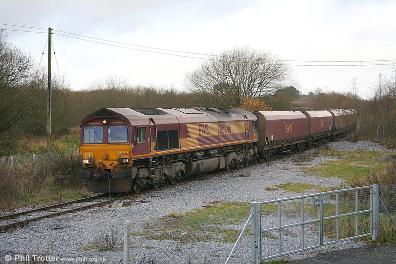 With Tower Colliery, the last deep mine in Wales, reportedly due to close in 2007 the section of the branch north of Aberdare faces uncertainty. Here, 66246 is seen at Hirwaun on 27th November 2006 with 6C45, 1054 Tower Colliery to Aberthaw Power Station.