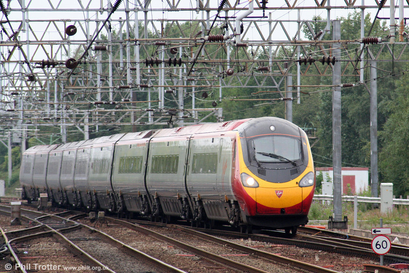 A Virgin Pendolino class 390 approaches Crewe Station from the north with a Euston-bound service on 5th August 2006.