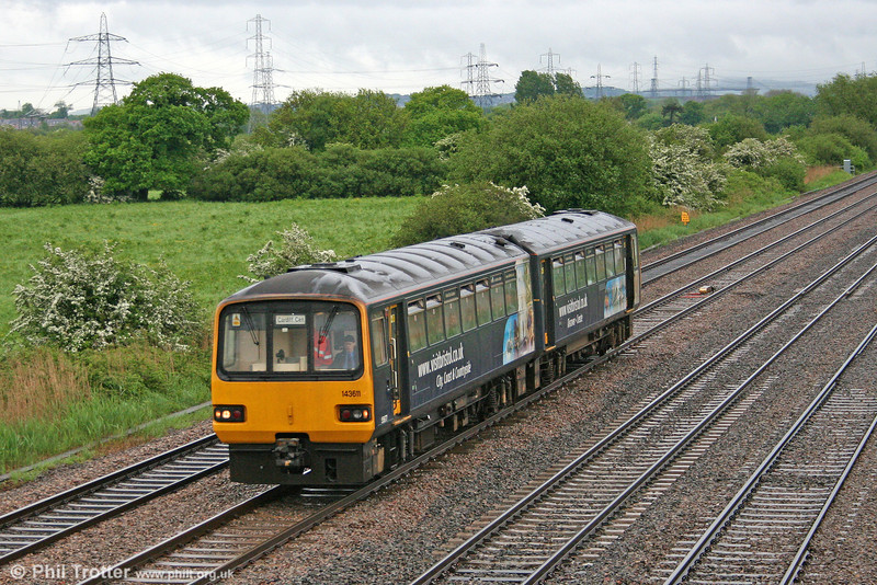 'Pacer' 143611 passes Coedkernew with a service from Taunton on 21st May 2006.