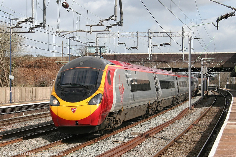 Heading north, a another Virgin 'Pendolino' class 390 passes Tamworth on 30th March 2006.