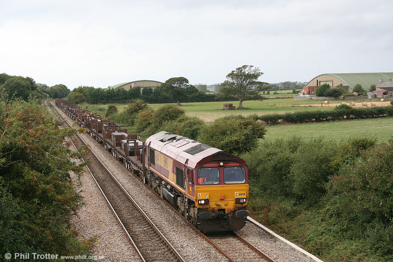 66144 passes St. Athan with 6H25, the 1045 Margam - Llanwern loaded steel on 2nd September 2006.