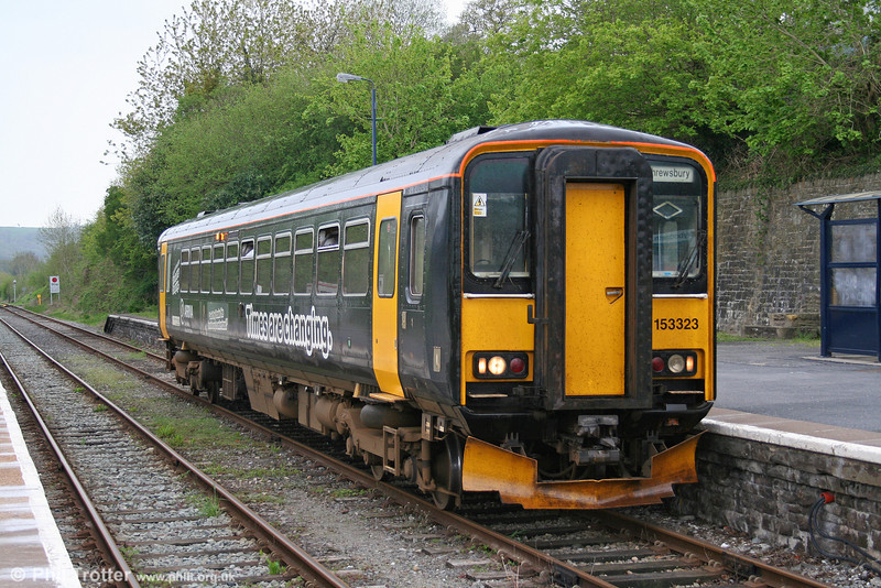 In a black livery to highlight the May timetable changes, 153323 calls at Llandeilo forming the 1317 Swansea to Shrewsbury on 6th May 2006.