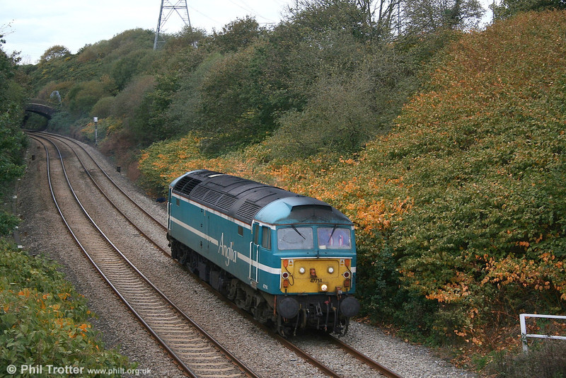 Having delivered FGW power car 43125 to Swansea Landore TMD, 47714 returns light engine through Llansamlet on 2nd November 2006.
