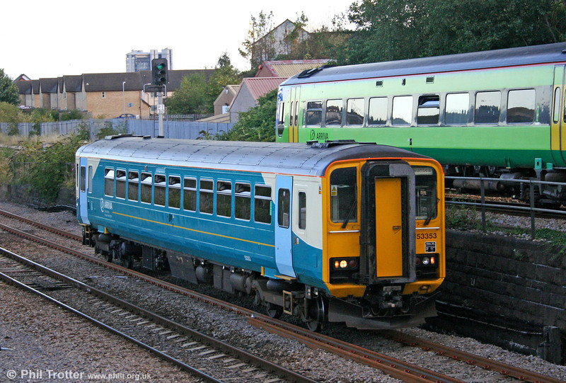 Arriva Trains Wales 153353, newly painted in Arriva corporate livery, leaves Swansea with the 1915 stopping service to Cardiff Central on 29th August 2006. This unit was formerly painted in Heart of Wales Line advertising livery. With 153353 clear, 158848 gets the road into Swansea with the 1710 Milford Haven to Manchester.