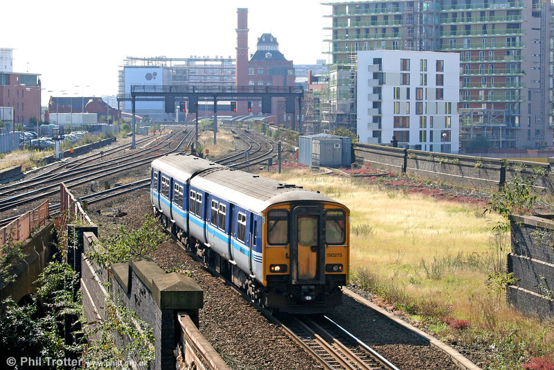 The Western approaches to Manchester Victoria present a somewhat derelict air. Here, Northern's 150275, still carrying the long-defunct 'Regional Railways' livery rolls in with the 1336 from Clitheroe and return on 9th September 2006.
