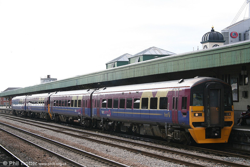 158765 heads a pair of Trans Pennine liveried units awaiting departure from Cardiff Central with a Cardiff to Portsmouth Harbour service on 4th August 2006.