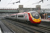 VWC 'Pendolino' 390038 'City of London' runs non-stop through Stafford on 23rd February 2006.
