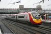 VWC 'Pendolino' 390038 'City of London' runs non-stop through Stafford on 23rd February 2006.