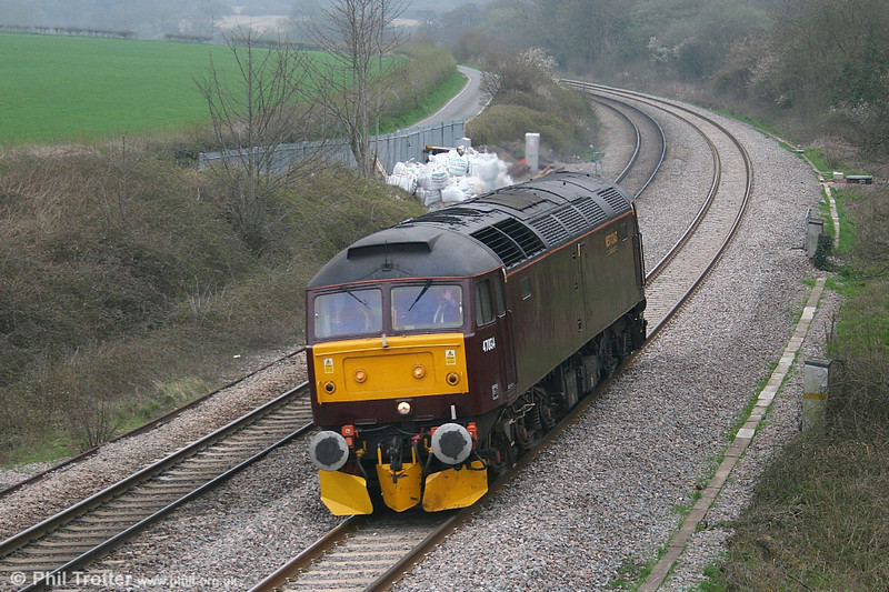 West Coast's 47854 passes Llangewydd running light from Newport to Carmarthen, having hauled the Birmingham to Newport leg of the 1Z77 'Pembroke Coast Express' on 22nd April 2006.